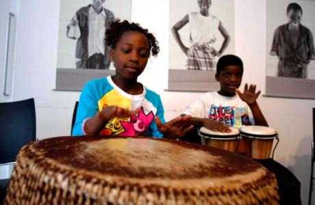Children taking part in a drumming workshop on family fun day, June 2013, in the Irish Aid Volunteering and Information Centre, Dublin