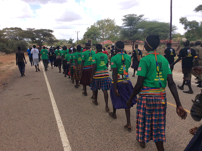 Karamajong (young girls and boys) marching for Aids to the venue of the launch