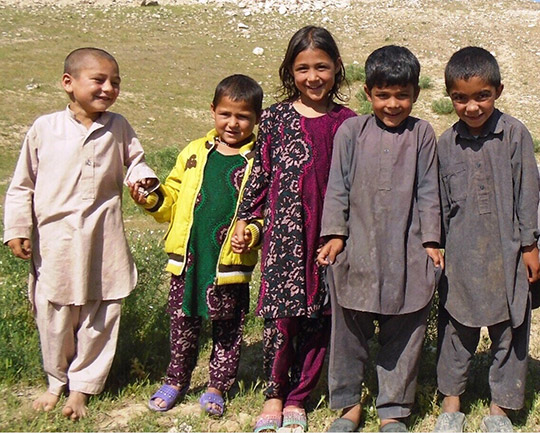 Four of Nesar's children pose for the camera at Task MF0029 in Irkali Village, Samangan. Credit: Halo Trust