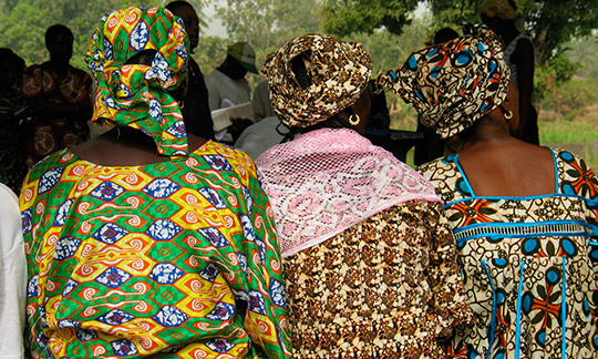 Women in colourful clothes gather in Sierra Leone