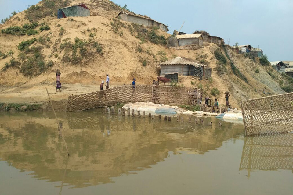 Photo of recently constructed temporary DAM to retain water at Nayapara, Refugee camp