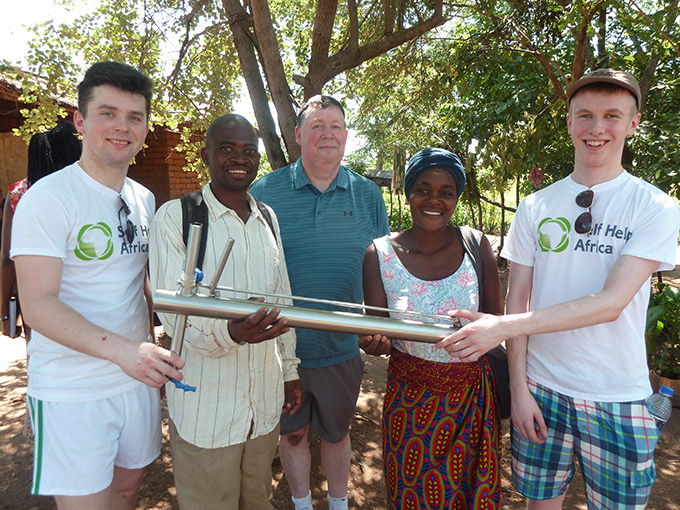 Winners of Irish Aid's BT Young Scientist award field test their project in rural Malawi