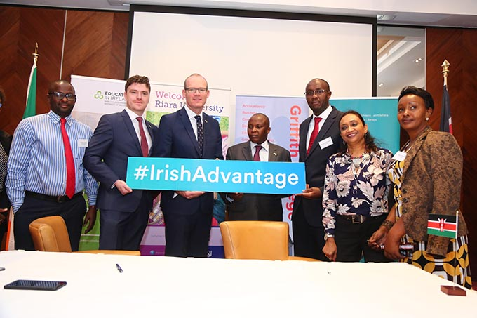 Minister Coveney with representatives of Riara University and Griffith College